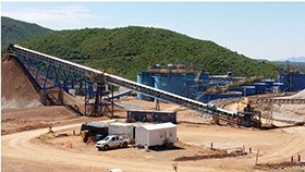 Pad Ore Recovery Conveyor and Stockpile with CCD Tanks in Background